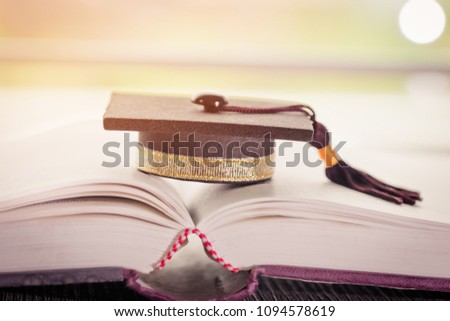 Graduation cap on Books in Library room of campus and university, Concept of knowledge Graduate abroad international Educational, Back to School