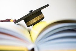Graduation cap on Books step in Library room, Concept of abroad international Educational, Back to School