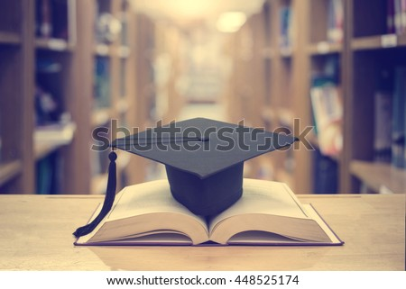 graduation cap over open Books on Library room,Education concept