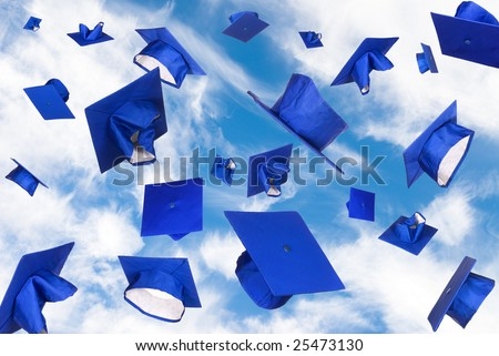 Graduation caps fly in the air in a moment of celebration