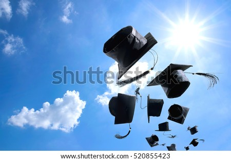 Graduation Ceremony, Graduation Caps, hat Thrown in the Air with blue sky abstract background.