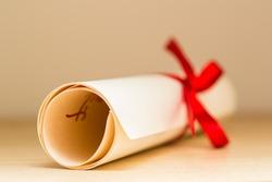 Graduation Diploma With Red Ribbon
