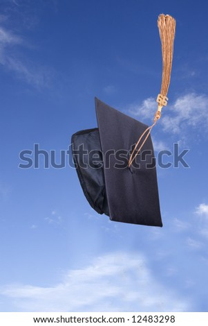 Graduation Hat in the Air under Blue Sky