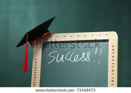 Graduation hat on the blackboard.