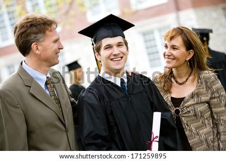 Graduation: Proud Male Student With Parents