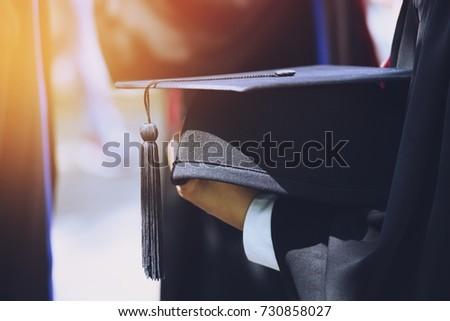 graduation,Student hold hats in hand during commencement success graduates of the university,Concept education congratulation.Graduation Ceremony,Congratulated the graduates in University.