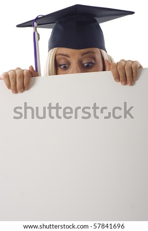Graduation woman looking at copyspace below isolated over a white background
