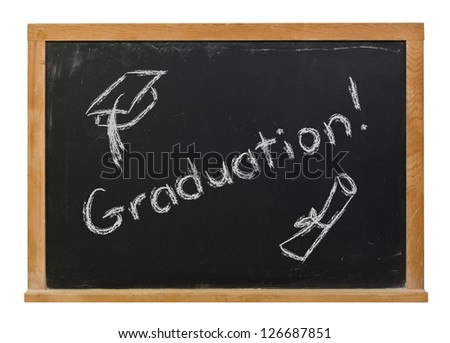 Graduation written in white chalk on a black chalkboard with a hand drawn cap and diploma