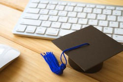 Graducate cap on keyboard with mouse, E-learning online education concept