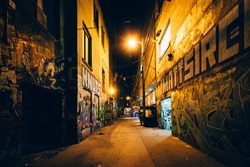 Graffiti Alley at night, in the Fashion District of Toronto, Ontario.