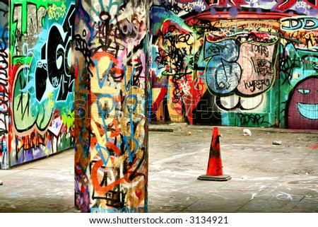 Graffiti and the traffic cone. A really nice image - stock photo