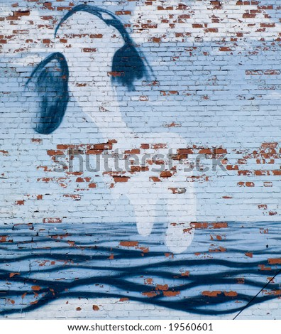 Graffiti of Whale on Brick Wall with Waves