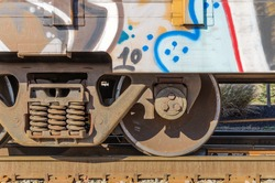 Graffiti on Container Loaded onto Tracks