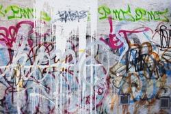 Graffiti wall in urban background of a wall