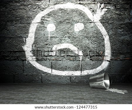 stock-photo-graffiti-wall-with-sad-face-