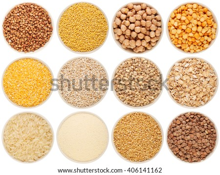 Grain and cereal food selection in porcelain bowls: buckwheat, millet, chick-pea, peas, crushed corn, crushed barley; barley, oat flakes, rice, semolina, crushed wheat; lentil. Isolated on white. #406141162