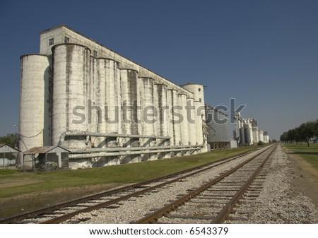 Grain and Rice Silos and Transportation Railroad - stock photo