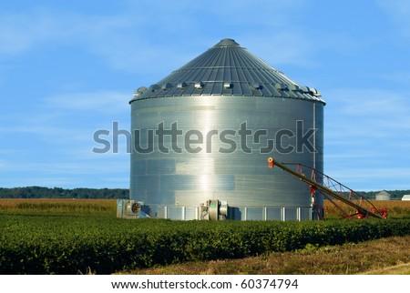 Grain Ben on an Iowa farm with a brilliant blue sky - stock photo