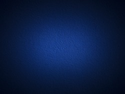 Grain dark blue paint wall background or texture