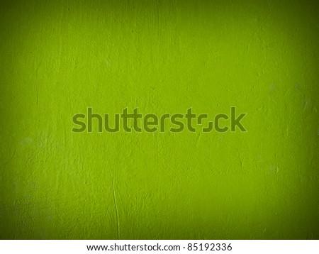 Grain dark green paint wall bakground or texture