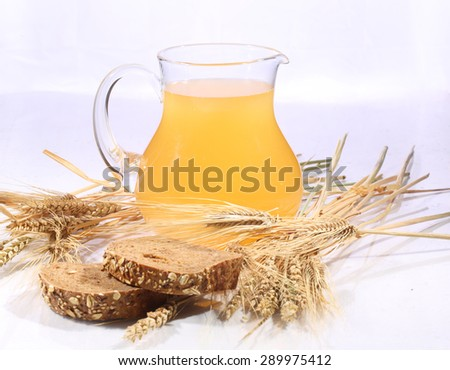 Grain drink - kvass (kvas) in a transparent jug on a white background