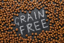 grain free dog food on black background