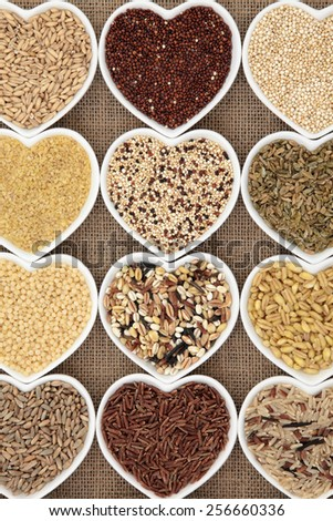 Grain selection in heart shaped dishes over hessian background.