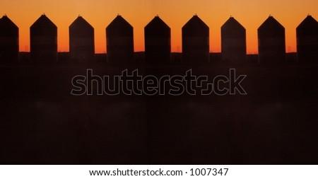 grain silos in silhouette