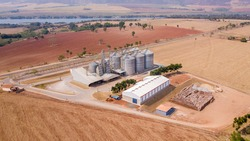 Grain storage silos in the field. agricultural concept. aerophotography. Drone image.