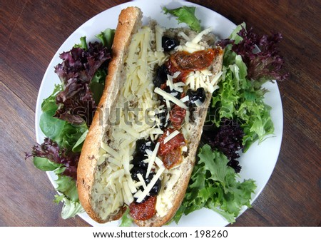 Grainary Baguette with Mozzarella, Black Olives and Sun-Dried Tomato