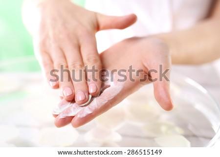 Grained hand peeling.Wellness and spa scrub hands. Grained hand peeling.The woman imposes on hand scrub cosmetic