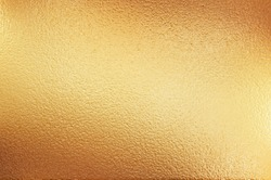 Graininess on a gold background. Dented gold background.