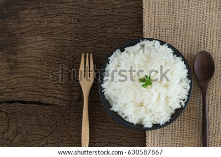 grains cooking of Thai jasmine rice or white rice in bowl on wooden Background #630587867