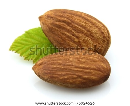 Grains of almonds with a leaf