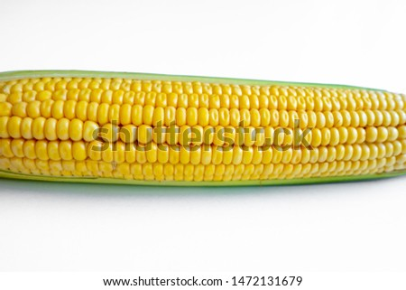 Grains of corn, dried corn isolated over a white background.