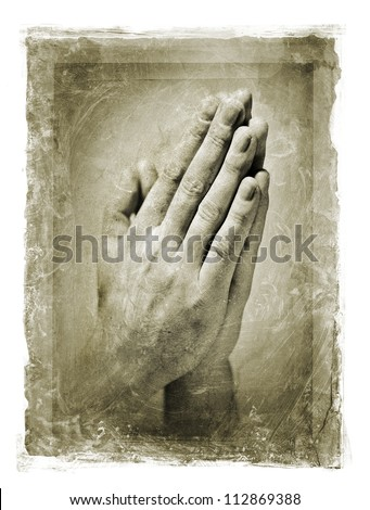 Grainy and stained image of hands clasped in a prayer.