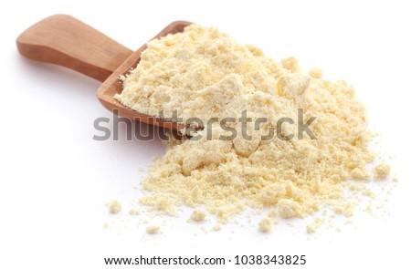 Gram flour closeup over white background #1038343825