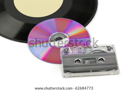 Gramophone disk, cd and cassette isolated on white background