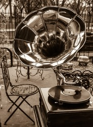Gramophone for sale at flea market in Paris. Aged photo. Sepia.