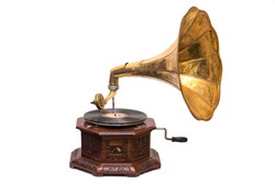 Gramophone is an Music device. Old gramophone with plate or vinyl disk on wooden box. Antique brass record player. Gramophone with horn speaker. Retro entertainment concept.