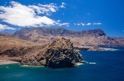 Gran Canaria, July, coastline of the north of the island, beach Playa del Juncal to the left, Puerto de las Nieves fishing village to the right