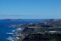 Gran Canaria, north of the island,  view from archaeological site Tagoror de Gallego in Santa Maria de Guia municipality  towards towards Las Palmas and La Isleta peninsula. Fuerteventura visible