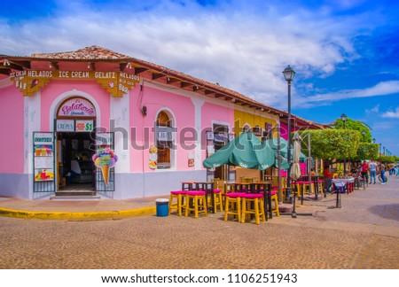 GRANADA, NICARAGUA - APRIL 28, 2016: View of market stalls at a colorful street in Granada, Nicaragua #1106251943