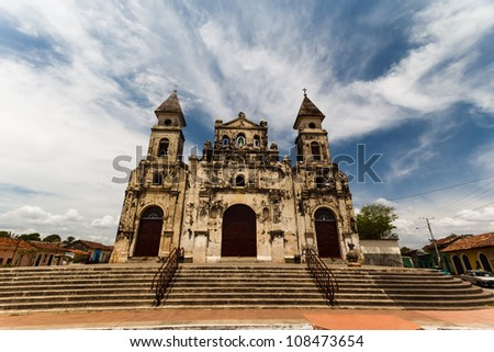 GRANADA, NICARAGUA: Facade of stone Spanish colonial Catholic church on the street in the historic district.