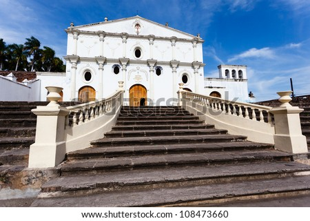 GRANADA, NICARAGUA: Facade of white stucco Spanish colonial church with grand staircase leading up to door.