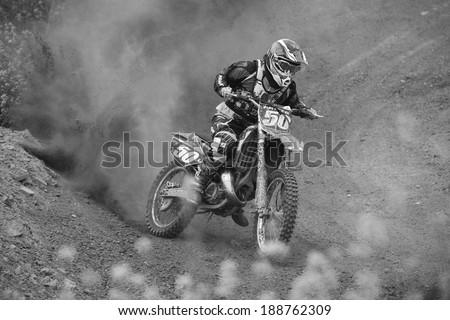 "GRANADA, SPAIN - APRIL 20 : Unknown racer on the competition "" Motocross Championship to Granada"" on April 20, 2014 in Granada, Spain #188762309"