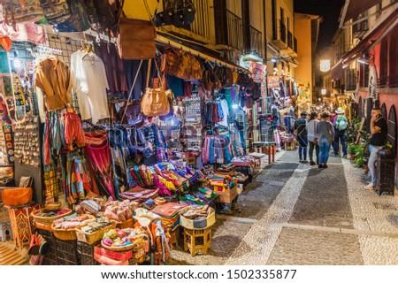 GRANADA, SPAIN - NOVEMBER 2, 2017: Various stalls in Calle Caldereria Nueva street in Granada. #1502335877