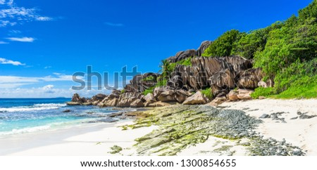 Grand Anse beach in La Digue island, Seychelles - nice granite boulders, perfect white sand and clear azure water