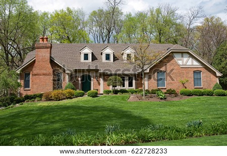 Grand Brick Home with Landscaped Lawn