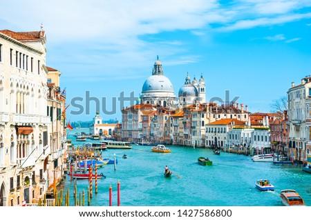 Grand Canal and Basilica Santa Maria della Salute in Venice, Italy. Famous tourist destination. Travel and vacation concept